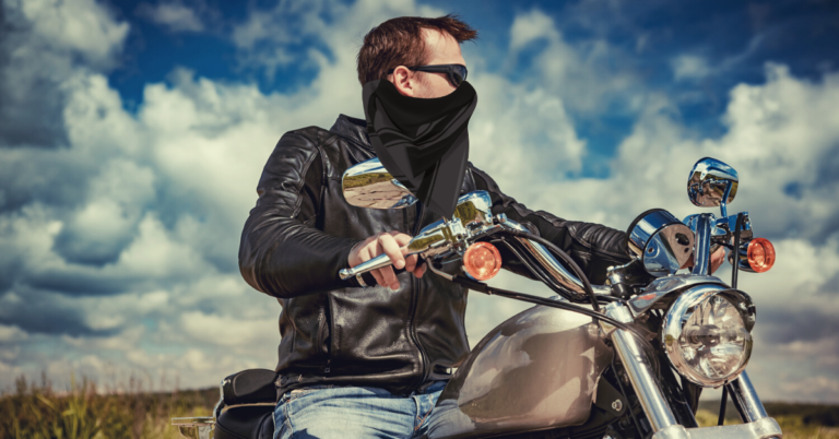 Man with a mask on a motorbike