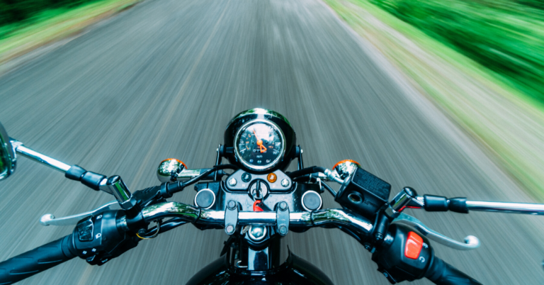 Speeding down a road on a motorcycle