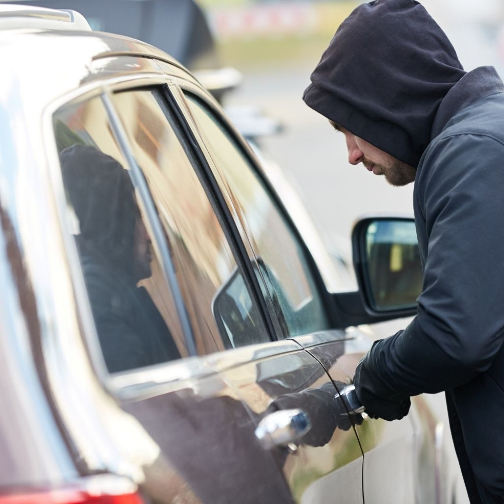 Thief Stealing Vehicle With A Car GPS Tracker